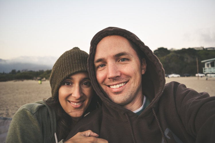 cute happy couple smiling selfie at beach