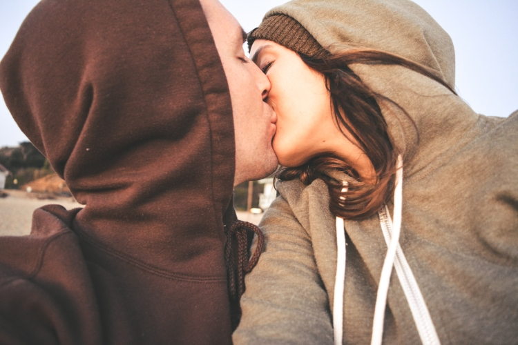 couple romantic kiss on beach selfie