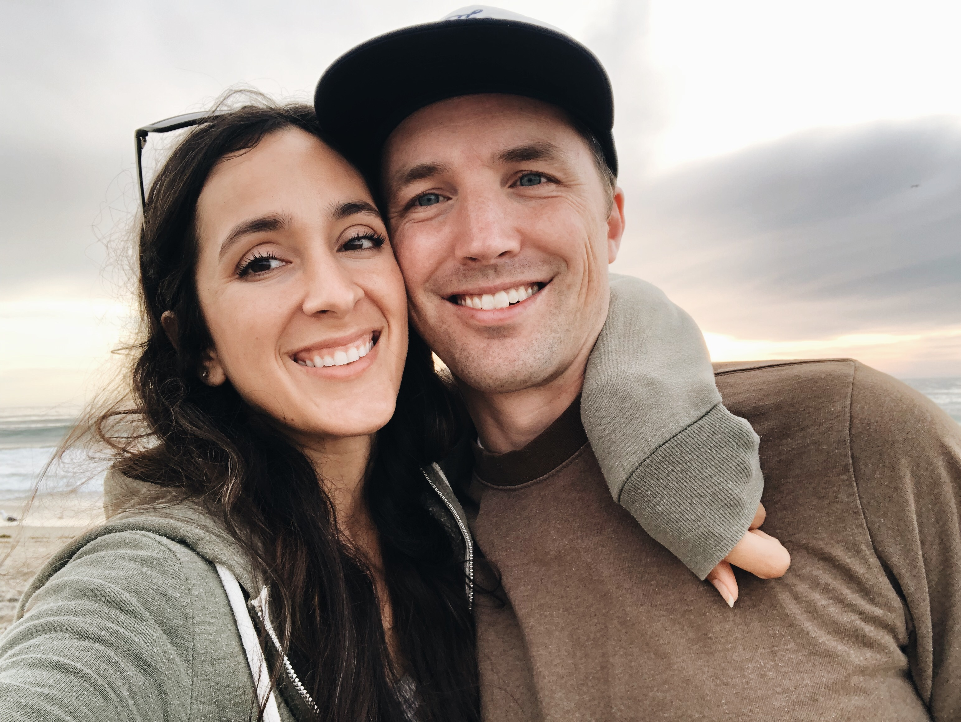 A husband and wife smiling, looking cute and happy.